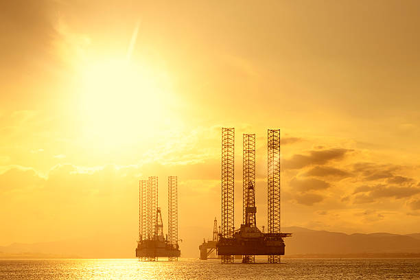 North Sea Oil Platforms at Sunset, Cromarty Firth, Scotland stock photo
