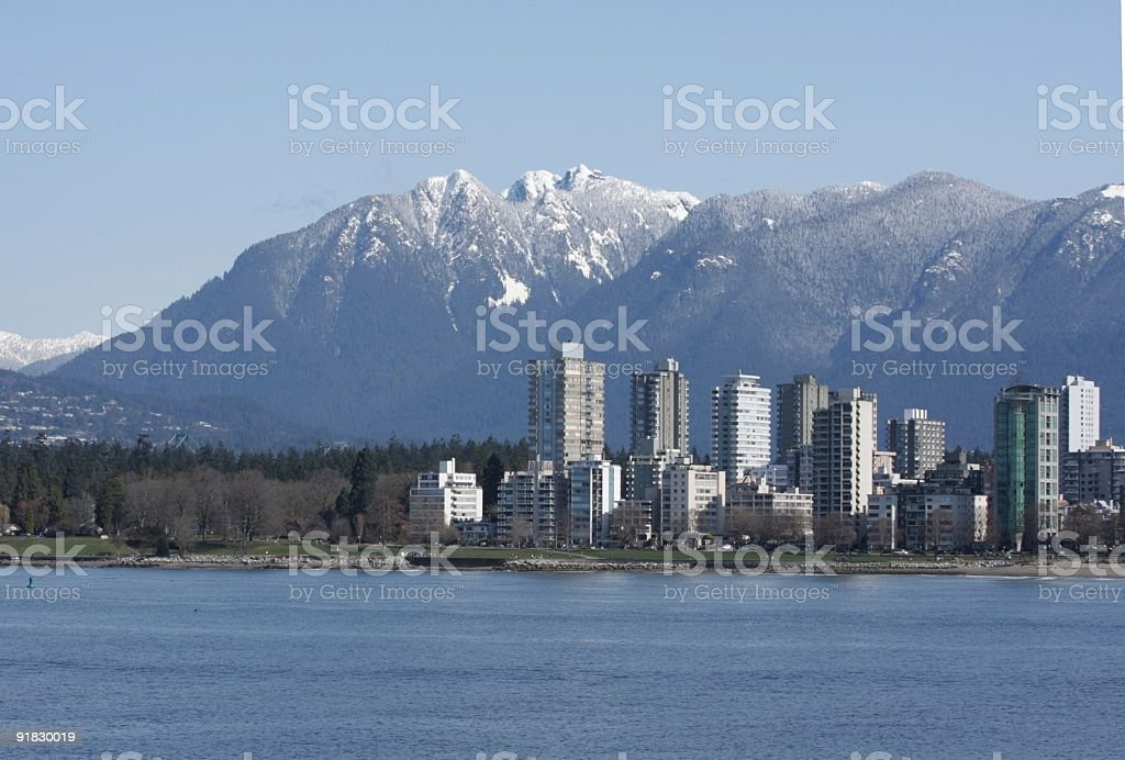North Shore Mountains and High-Rises Along English Bay in Vancouver stock photo