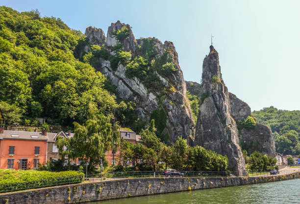 North side of Le rocher Bayard along Meuse River in Dinant, Belgium. stock photo