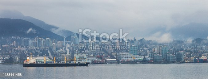 North Vancouver Skyline in the fog with tankers.