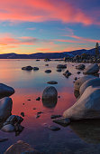 The northern part of Lake Tahoe straddles the border between Calfiornia and Nevada. It's dominant features are big glaciated boulders and clear blue waters.