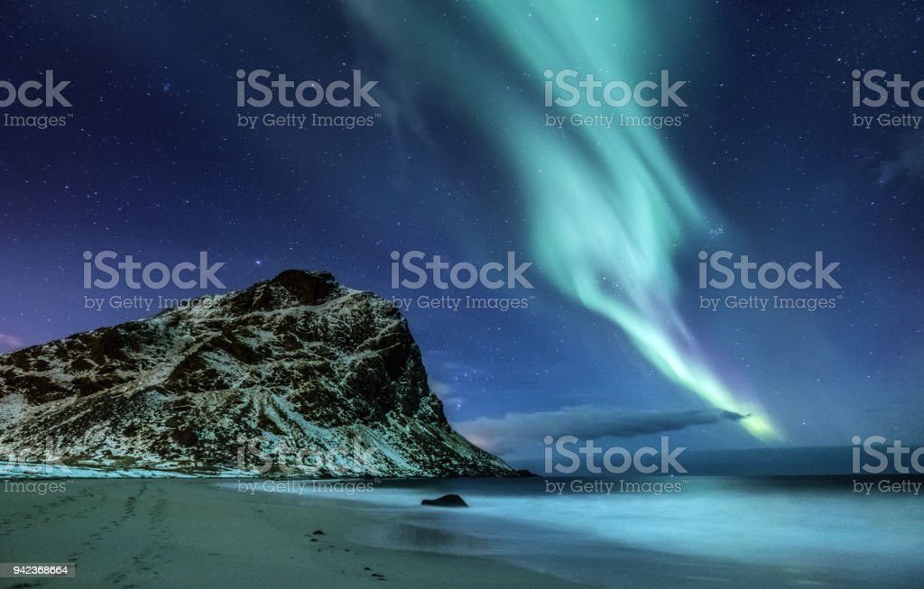 Northen light under mountains and ocean. Beautiful natural landscape in the Norway stock photo