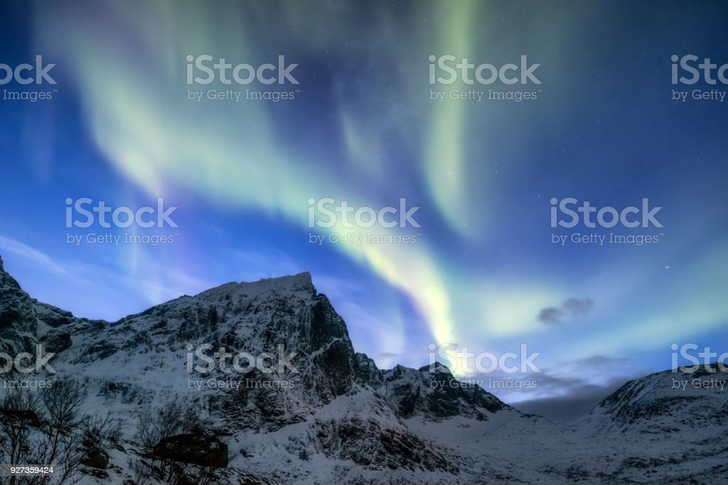 Northen light under mountains. Beautiful natural landscape in the Norway - Royalty-free Astronomy Stock Photo