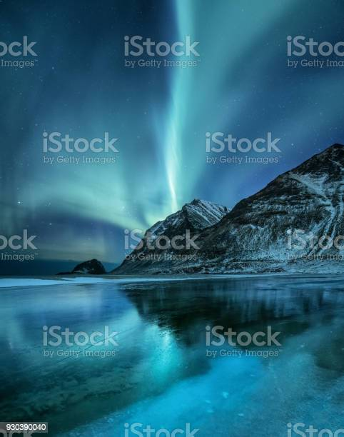 Photo of Northen light under mountains. Beautiful natural landscape in the Norway