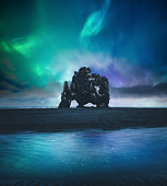 Northen lights over Hvitserkur rock formation at the beach (Vatnsnes peninsula, northwest Iceland).