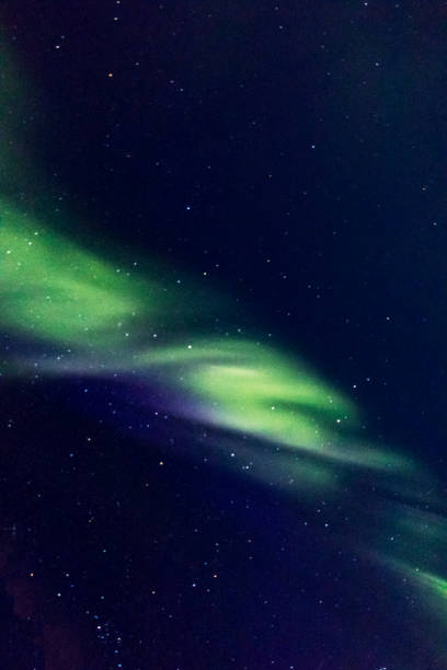 Northern Boreal Lights in the sky while sailing across the northwest passage in Canada. stock photo