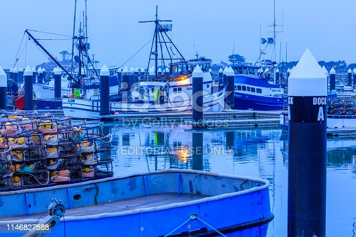 Crescent City harbor in California on February 13, 2016: Commercial fishing vessels docked in the Crescent City harbor at dusk on the Northern California coast