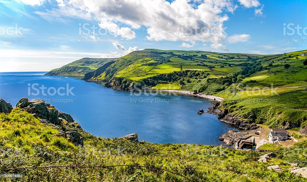 Northern coast of County Antrim, Northern Ireland Northern coast, a bay and a small harbor in County Antrim, Northern Ireland, UK Atlantic Ocean Stock Photo