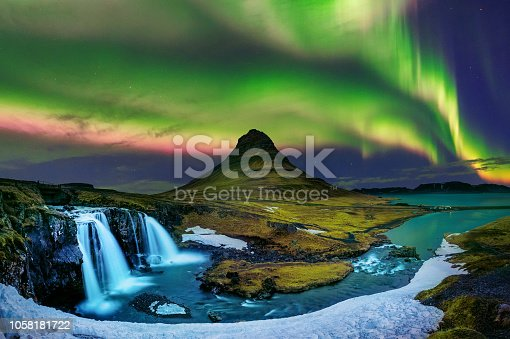istock Northern Light, Aurora borealis at Kirkjufell in Iceland. Kirkjufell mountains in winter. 1058181722