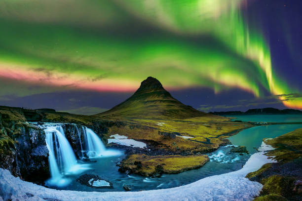 Northern Light, Aurora borealis at Kirkjufell in Iceland. Kirkjufell mountains in winter. stock photo