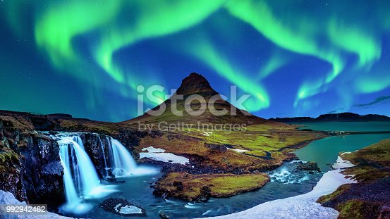 istock Northern Light, Aurora borealis at Kirkjufell in Iceland. Kirkjufell mountains in winter. 992942462