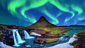 Northern Light, Aurora borealis at Kirkjufell in Iceland. Kirkjufell mountains in winter.