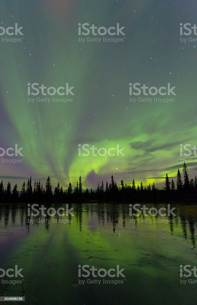 Northern light, aurora borealis, reflecting in ice stock photo