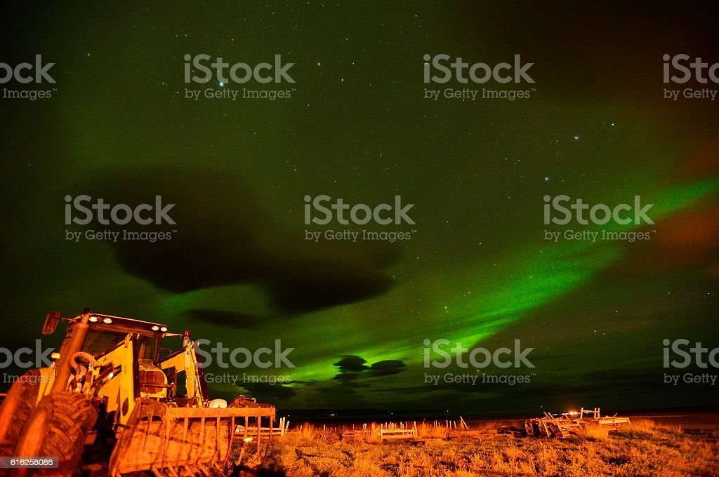 Northern light over a farm house in Iceland stock photo