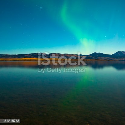 istock Northern lights and fall colors at calm lake 154215765