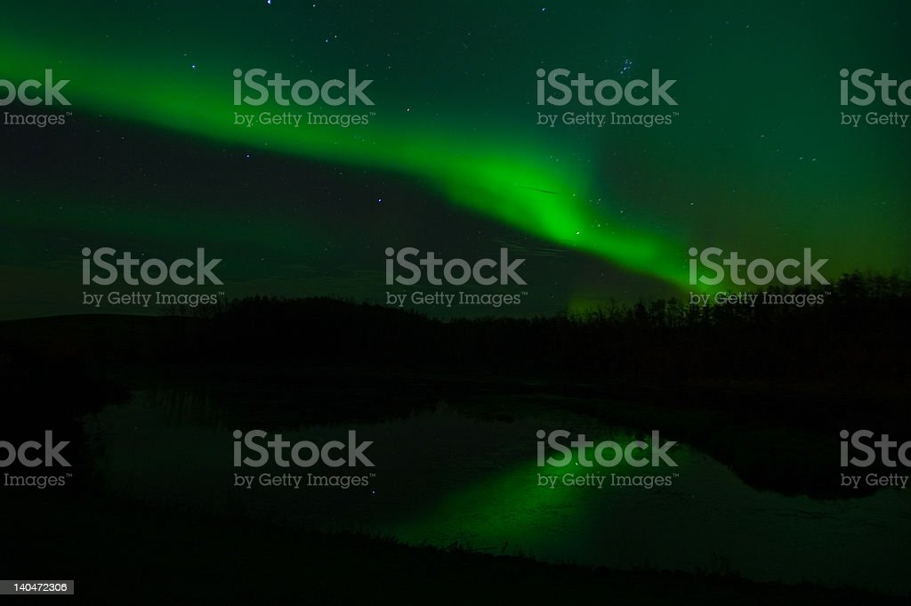 Northern Lights and reflection in water royalty-free stock photo