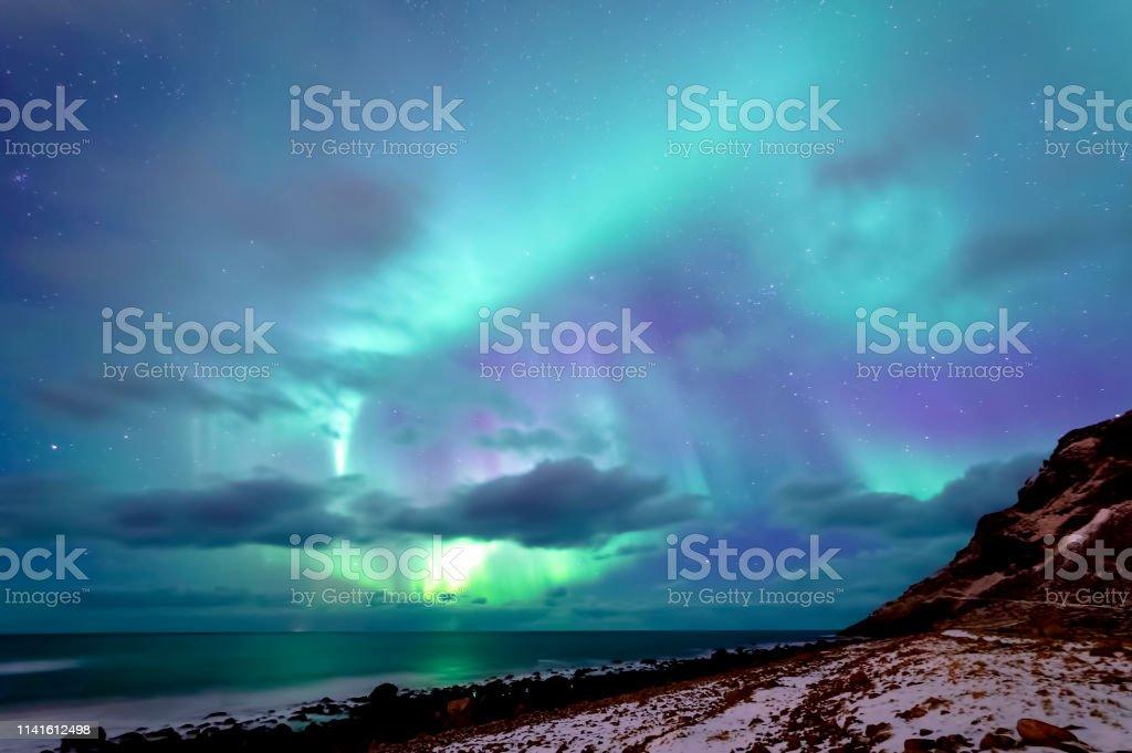 Northern Lights at Unstad Beach stock photo