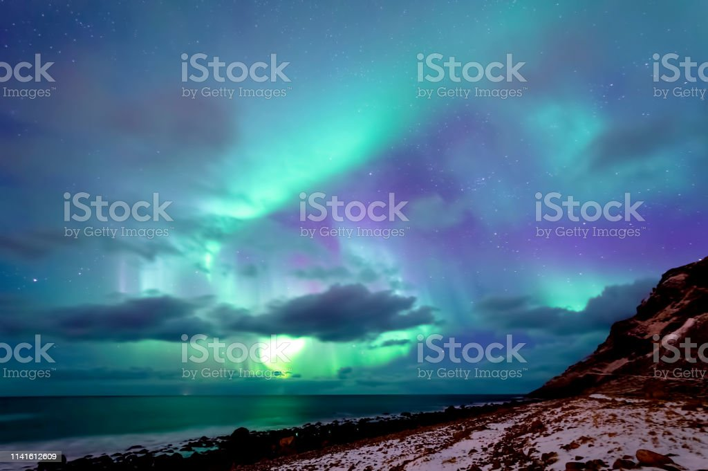 Northern Lights at Unstad Beach stock photo