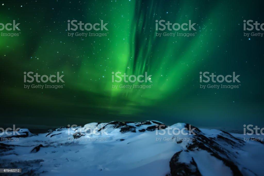 Northern lights. Aurora borealis nature landscape at night royalty-free stock photo