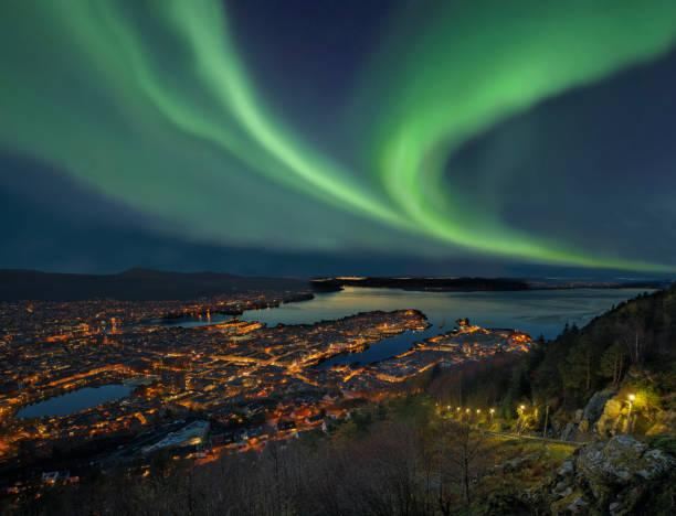 Northern lights - Aurora borealis over harbor of Bergen City, Norway stock photo
