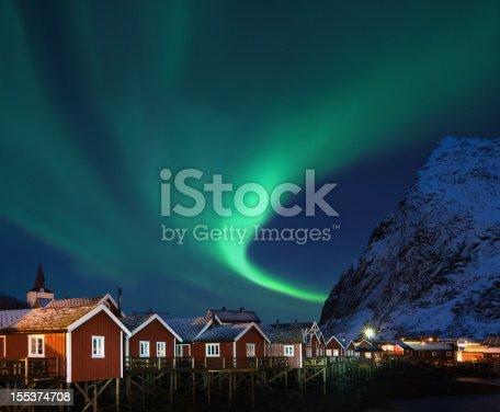 istock Northern lights - Aurora borealis over Reine, Lofoten, Norway 155374708