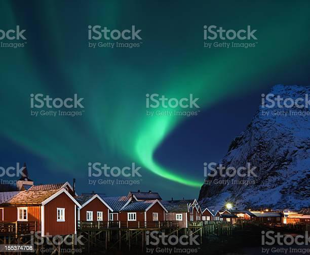 Northern Lights Aurora Borealis Over Reine Lofoten Norway Stock Photo - Download Image Now