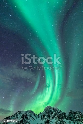 Northern Lights background image with only sky and Aurora Borealis in the starry night over the Lofoten in Northern Norway.