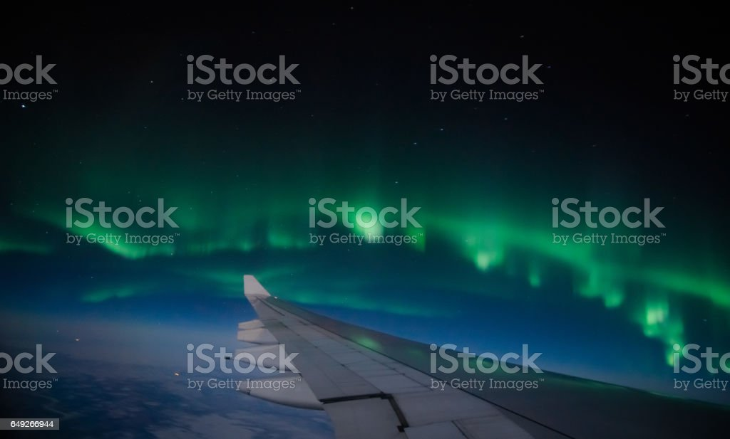 Northern lights (Aurora Borealis) from the airplane stock photo
