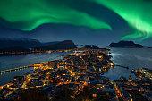 Green Aurora borealis over Alesund, Norway.