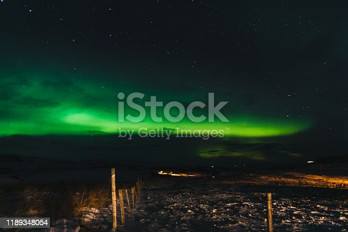 Scenic view of Aurora dancing in the countryside on the North Iceland