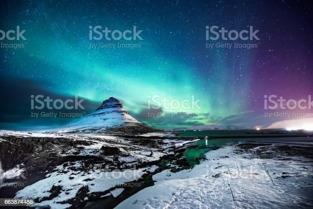 Northern lights in mount kirkjufell iceland with a man passing by picture id663874486?b=1&k=6&m=663874486&s=612x612&h=lh51f4 n7qq 9zb7vzwmr6oj 73suyzx3hao zbv3tw=
