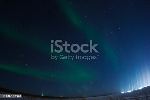 Northern Lights in the night sky. Northern Lights in the tundra.