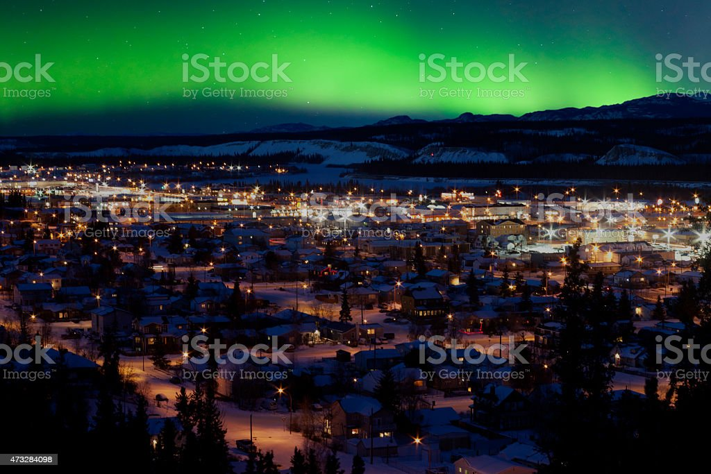 Northern Lights over Downtown Whitehorse stock photo