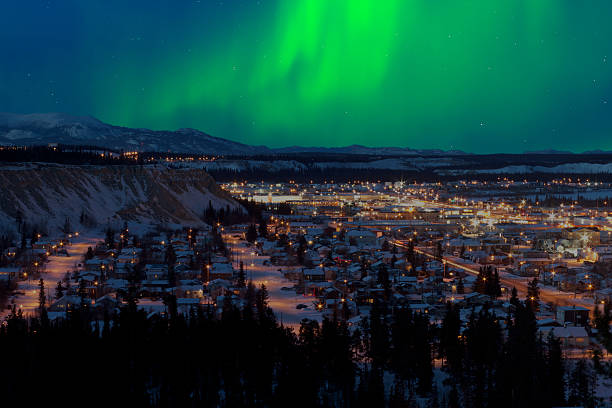 northern lights over downtown whitehorse - northern lights bildbanksfoton och bilder