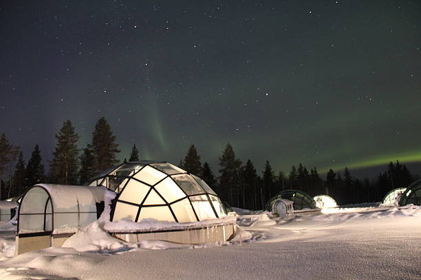 northern lights over glass igloos in finland - finland stock pictures, royalty-free photos & images