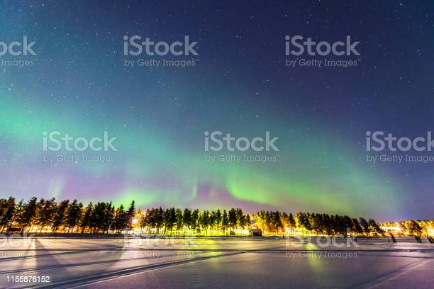 Photo of Northern lights over Jokkmokk and the Lake Talvatis, in the heart of Swedish Lapland within the Arctic Circle