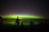 Beautiful northern lights aurora borealis over lake in finland