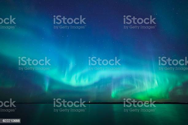 Photo of Northern lights over lake in finland