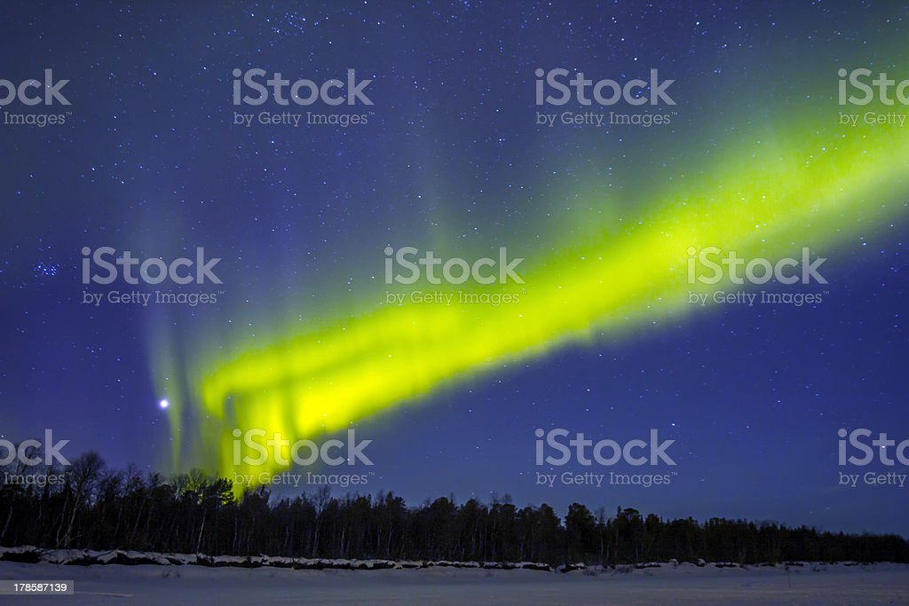 Northern Lights (Aurora borealis) over snowscape. royalty-free stock photo