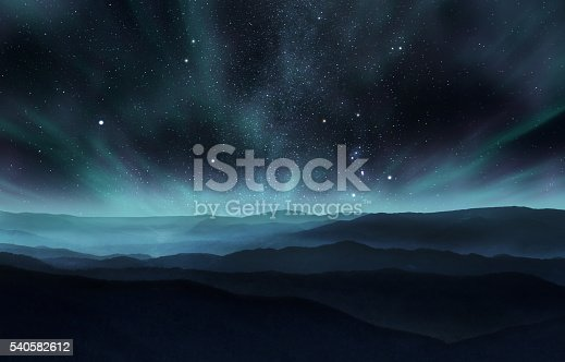 Starry night sky with aurora over the hills