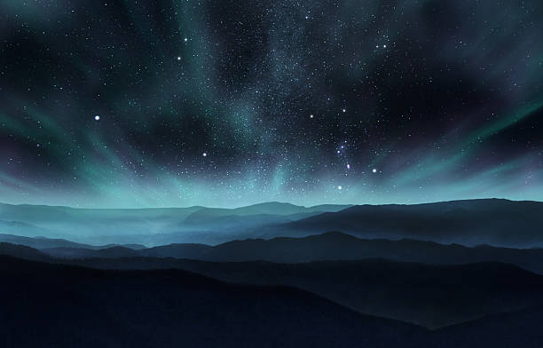 Northern lights Starry night sky with aurora over the hills atmospheric mood stock pictures, royalty-free photos & images