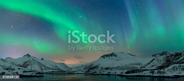 istock Northern Lights, polar light or Aurora Borealis in the night sky over the Lofoten islands in Northern Norway 976558130