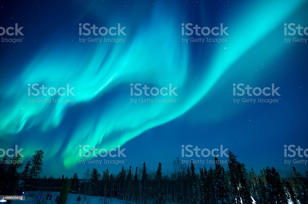 Northern lights stream across the arctic sky near Yellowknife stock photo