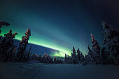 istock Northern lights with heavy snow 922391174