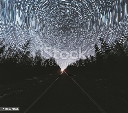 The stars spin above a stretch of railroad tracks in rural Nova Scotia.  Long exposure.