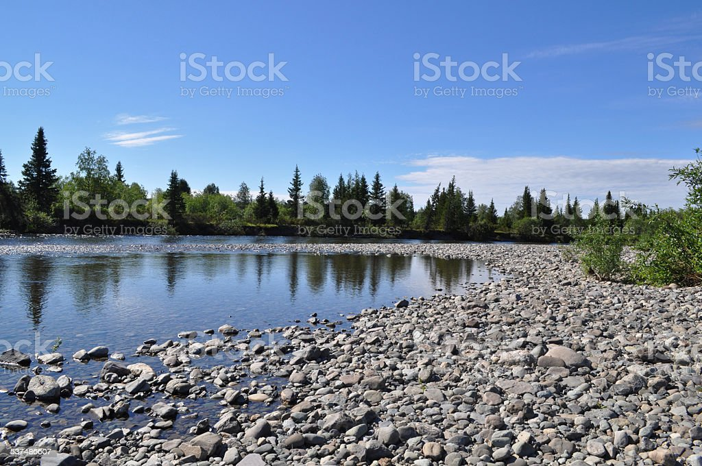 Northern river from the pebbly shores. stock photo