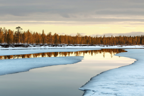 Melting ice, reflections, wonderful colors & clouds, northern spring, location: Finnish Lapland, near to Inari.