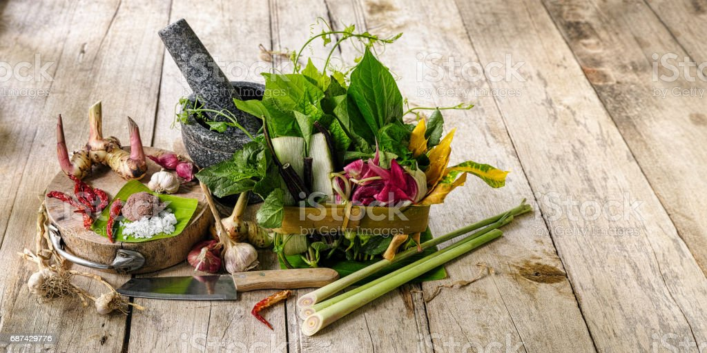 Northern Thai herbs, spices and vegetables for a Northern Thai traditional recipe called 'Gaeng Khae', which is a curry made of a seasonal mix of flowers and herbs, and can be cooked with free range chicken or pork. stock photo