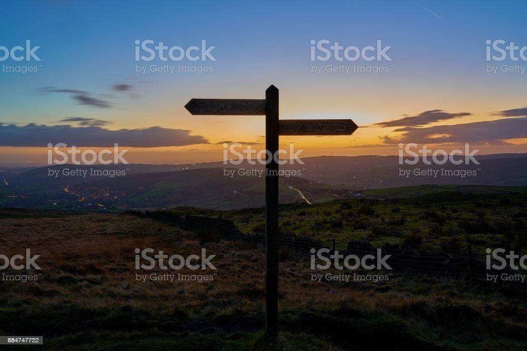 North-south signpost silhoutte. stock photo