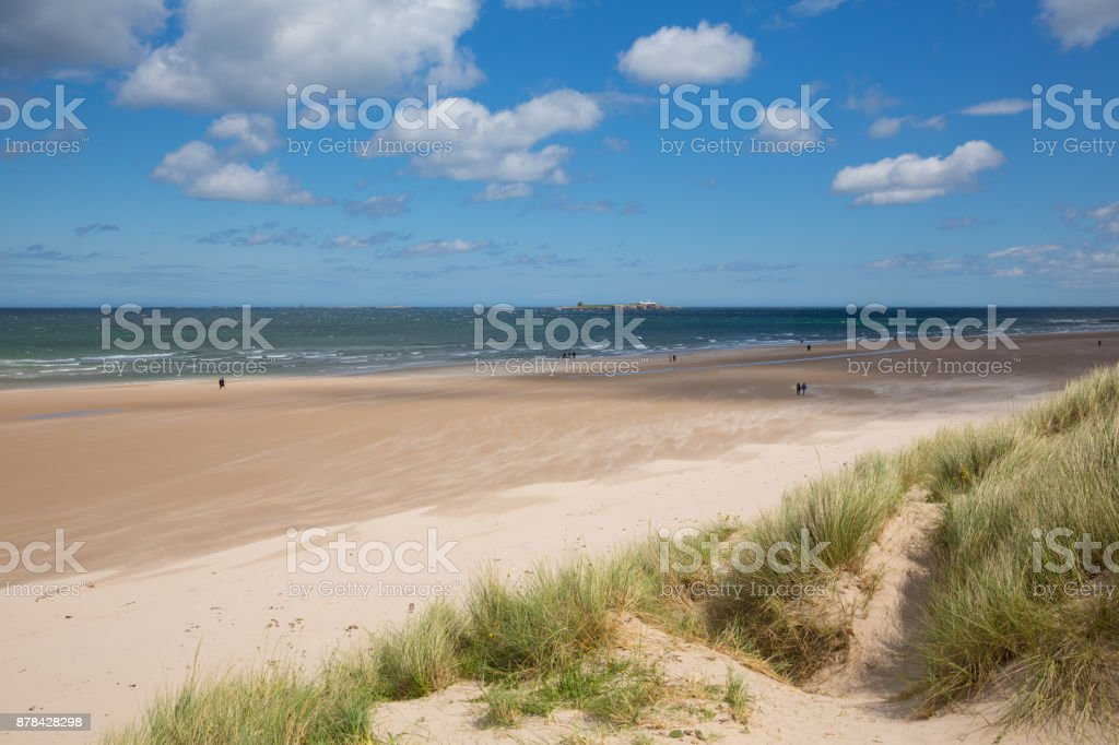 Northumberland beach and coast at Bamburgh north east England UK with view to the Farne island stock photo